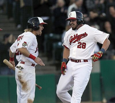 Goldeyes Shawn Pleffner and Josh Romanski celebrate Pleffner&#39;s home run to score the 7th, 8th and 9th runs for the Goldeyes.</p>