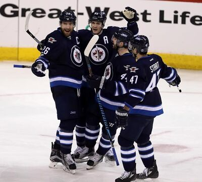 Winnipeg Jets' Blake Wheeler (26), Mark Scheifele (55), Josh Morrissey (44) and Brian Strait (47) celebrate after Wheeler scored a game last March.  (Trevor Hagan / Winnipeg Free Press). Wheeler and Scheifele are speaking the hard truth: this Jets team is out of excuses and time is up for the Jets to make the transition from promising upstart to legitimate contender.