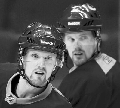 Darryl Dyck / the canadian press archivesDaniel and Henrik Sedin have signed twin contracts in Vancouver.
