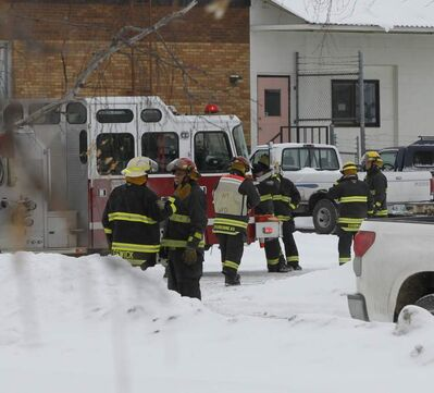 Winnipeg firefighters outside Smooth Freight on Milner Street attend a possible chemical spill Tuesday afternoon.