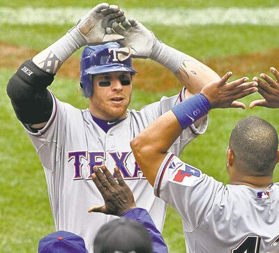 Josh Hamilton is taking his home run power to  AL-rival Los Angeles Angels.