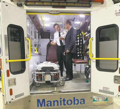 Winnipeg Fire and Paramedic Service Chief Reid Douglas with Mayor Sam Katz in a new ambulance.