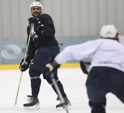 Dustin Byfuglien skates with teammates for the first time this season at MTS Iceplex.