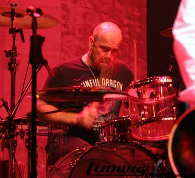 """Drummer Jason Bonham performs during Foreigner's concert in Tokyo in 2007. At 17, Jason Bonham had a decision to make. He loved motorcycles, and was good enough to become a professional racer. But he also had a legacy to deal with. His father, John Bonham, the legendary drummer for Led Zeppelin, had just died a few years before and Jason had grown up with music. Before the age of 10, he appeared in the film on his father's band, """"The Song Remains the Same."""" Bonham decided to follow in his father's footsteps."""