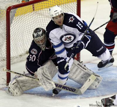 The Jets' Jim Slater appears to be on the brink of goaltender interference on Blue Jackets goalie Paul Dainton Tuesday in Ohio.