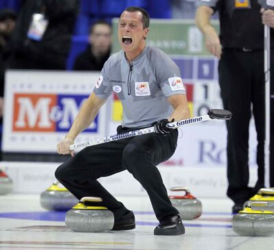 E.J. Harnden roars in triumph after Brad Jacobs' final shot comes to rest.