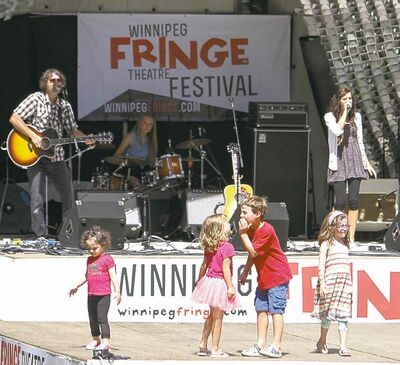 The Rachel Ashley band performs at the Cube while children dance and play in the Old Market Square on Saturday afternoon, which marks the second last day of the Winnipeg Fringe Festival. Saturday, July 27, 2013.  (JESSICA BURTNICK/WINNIPEG FREE PRESS)