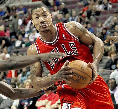 CORRECTS STATE TO MICHIGAN, INSTEAD OF FLORIDA - Chicago Bulls guard Derrick Rose, right, drives on Detroit Pistons guard Will Bynum in the first half during an NBA basketball game in Auburn Hills, Mich., Sunday, April 15, 2012. (AP Photo/Paul Sancya)