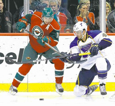 Wild left-winger Zach Parise (left) is off to a strong start with three goals in his first three games this season.