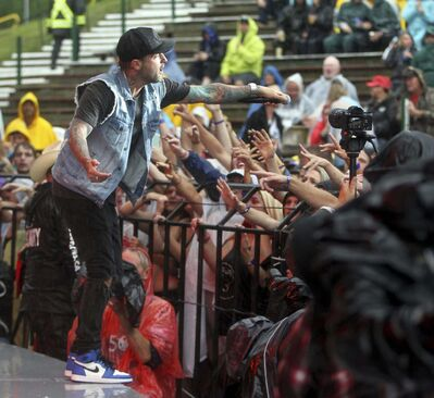 Dallas Smith urges the soaked crowd to sing along during a sustained downpour Friday. (Tim Smith / The Brandon Sun)