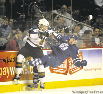 Manitoba forward Jason Jaffray (left) dishes out a heavy hit on Toronto's Jiri Tlusty during Wednesday night's Game 1 at the MTS Centre.