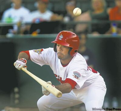 Goldeyes rookie Ridge Carpenter fouls off an attempted bunt Wednesday at Shaw Park. He later hit a run-scoring double.
