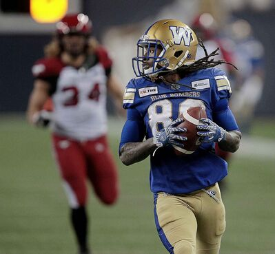 Blue Bombers' Janarion Grant runs a missed Stampeders convert back for 2 points in the second half at IG Field Friday.