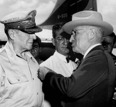 THE ASSOCIATED PRESS FILES</p><p>U.S. President Harry S. Truman pins a medal on the shirt of Douglas MacArthur in October 1950. He fired the general the next year.</p>