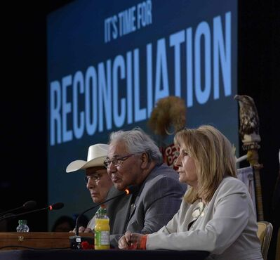 Commission chairman Justice Murray Sinclair (centre) and fellow commissioners Marie Wilson (right) and Wilton Littlechild discuss the commission's report on Canada's residential school system at the Truth and Reconciliation Commission in Ottawa on Tuesday.