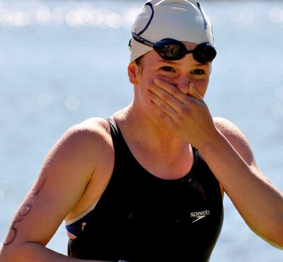 Kendra Garagan is photographed finishing a swim leg of her first triathlon.