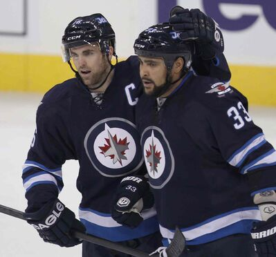 Andrew Ladd and Dustin Byfuglien are both scheduled to become unrestricted free agents next summer.