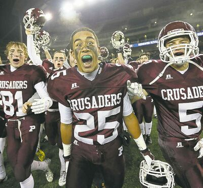 From left: Matt MacDonald, Hayden Mushinski and Teagan Horton of the AAA St.Paul's Crusaders whoop it up.