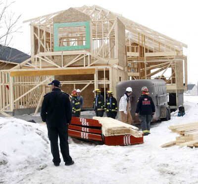 Winnipeg Fire Deptartment is at the scene of a house construction site on Amber Trail Thursday morning where a worker was sent to the hospital after being crushed by trusses.