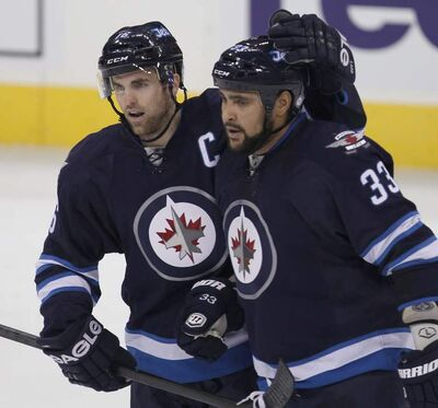 Winnipeg Jet Andrew Ladd, left, with teammate Dustin Byfuglien.