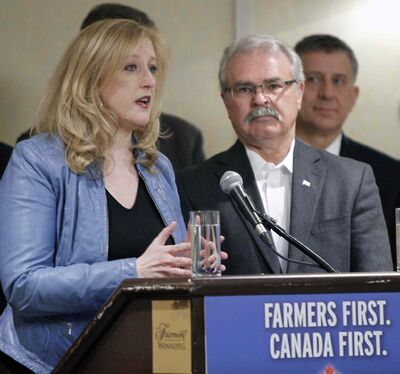 Transport Minister Lisa Raitt and Agriculture and Agri-Food Minister Gerry Ritz at the federal announcement in Winnipeg Friday morning.