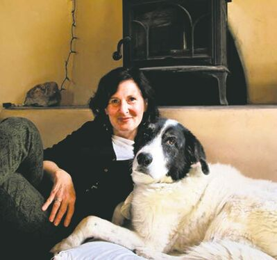 Heidi Schulman with her dog Bosco, whose intuitive nature inspired her to create tarot cards to communicate with canines.