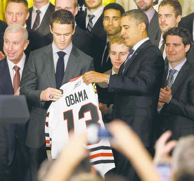Pablo Martinez Monsivais / the associated pressPresident Barack Obama is presented with a Chicago Blackhawks jersey by Blackhawks captain Jonathan Toews during a ceremony at the White House Monday.