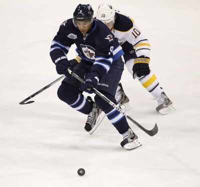 Winnipeg Jets' Evander Kane is chased by a Buffalo Sabres player during a game in Winnipeg in March, 2012.