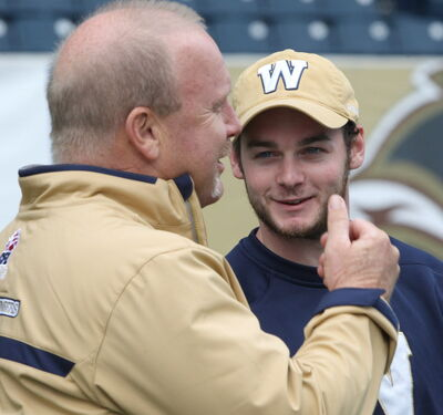 Bombers director of scouting Drew Morris, right  with Bombers assistant GM Danny McManus  at practice Thursday morning at Investors Group Field.