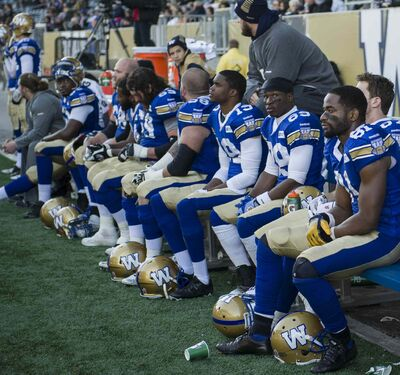 The Winnipeg Blue Bombers look dejected on the sidelines during the final moments of Saturday afternoon's game against the Hamilton Tiger-Cats.
