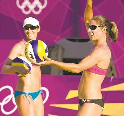 Ryan Remiorz / The Canadian Press Canadians Annie Martin (right) and Marie-Andree Lessard have to watch out for nuts buried in the beach volleyball practice courts by unscrupulous squirrels.