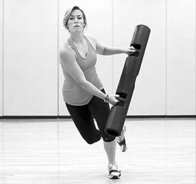 Andrew Stanfill / MCTAmbre Sheehy, a fitness co-ordinator with the University of Florida, demonstrates a �skater while standing� exercise with a ViPR.