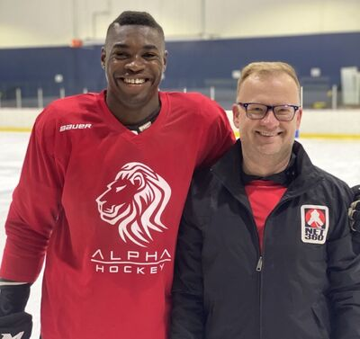 Steinbach player agent Ray Petkau with Germaine Loewen.