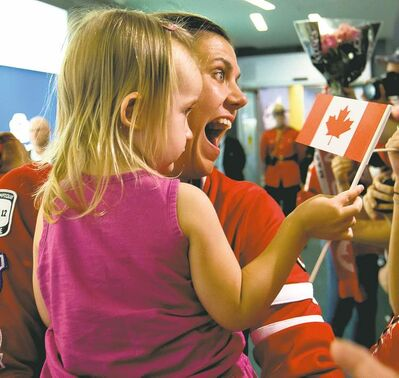 darryl dyck / the canadian pressCanadian women�s soccer team captain Christine Sinclair holds her two-year-old niece Kaitlyn Sinclair as she returns to Vancouver International Airport.