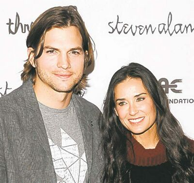 "In this April 14, 2011 file photo, Ashton Kutcher and Demi Moore attend the ""Real Men Don't Buy Girls"" launch party, to raise awareness about child sex slavery, at the Steven Alan Annex in New York.  Moore is ending her marriage to Ashton Kutcher. The 49-year-old actress said Thursday, Nov. 17, 2011, that ""it is with great sadness and a heavy heart that I have decided to end my six-year marriage to Ashton."""