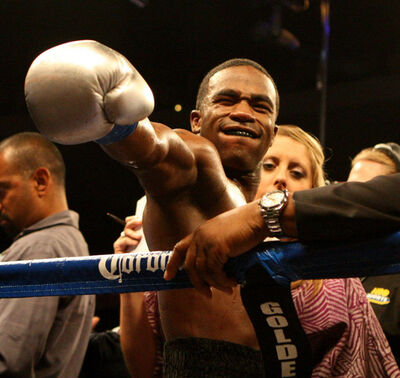 Adrien Broner, from Cincinnati, Ohio gestures to fans after beating Vicente Escobedo, Woodland, Calif. in the 5th round during their WBO Junior Lightweights title fight at US Bank Area Saturday July 21, 2012 in Downtown, Cincinnati. (AP Photo/The Enquirer, Joseph Fuqua II)