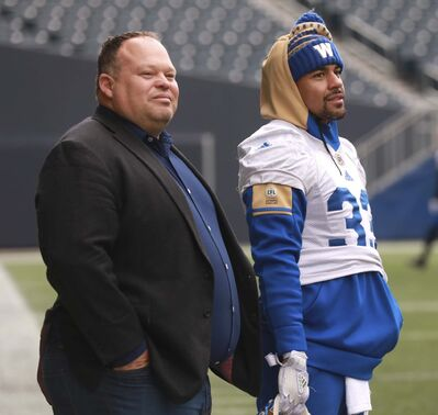 RUTH BONNEVILLE / WINNIPEG FREE PRESS FILES</p><p>Winnipeg Blue Bombers running back Andrew Harris, right, watches practice with team President &amp; CEO Wade Miller in October. Harris and Miller will both be doing whatever they can to attract and retain free agents this off-season.</p>