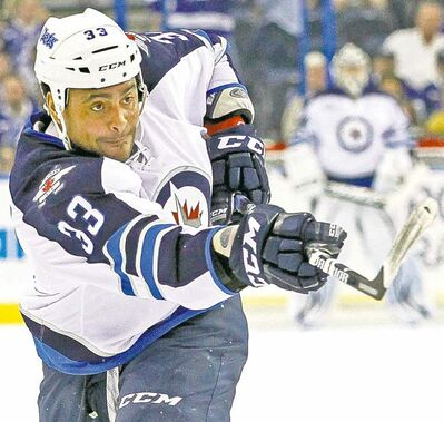 Dustin Byfuglien is third in scoring among all NHL defencemen.
