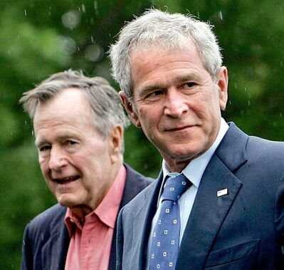 Former presidents George H. Bush and his son George W. Bush.