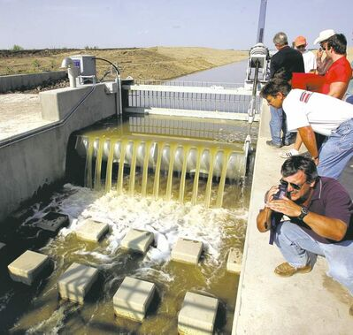 The opening of the Devils Lake outlet gate at the end of the canal near the Sheyenne River on Aug. 15, 2005.