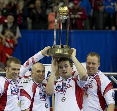 Canada skip Jeff Stoughton, left to right, third Jonathan Mead, second Reid Carruthers and lead Steve Gould celebrate their team's gold medal win over Scotland at the Ford World Men's Curling Championships in Regina, Sask., Sunday, April 10, 2011.