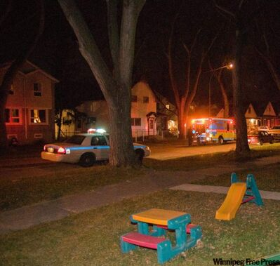 Police investigate the scene of a shooting on Boyd Avenue Saturday night.