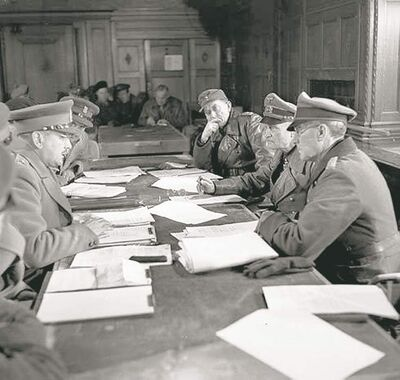 Lt.-Gen. Charles Foulkes (left), commander of the First Canadian Corps, accepts the surrender of the German army from General Johannes Blaskowitz (right) at Wageningen, the Netherlands, on May 5, 1945.