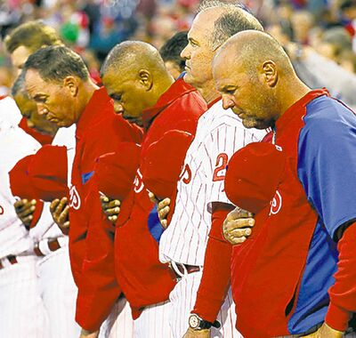 YONG KIM / MCTPhiladelphia Phillies observe a moment of silence in honour of the Navy Yard shooting victims.