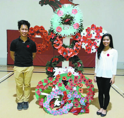 Isaac Brock School student council president John Demanoy (left) and vice-president Maria Aragon were emcees of the Remembrance Day ceremony at the West End school.