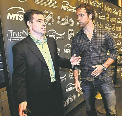 Scott Brown (left) with Jets captain Andrew Ladd.