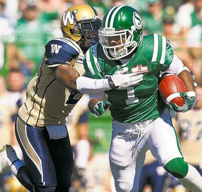 liam richards / the canadian pressBlue Bombers cornerback Jovon Johnson tackles Roughriders running back Kory Sheets during Sunday�s game in Regina.