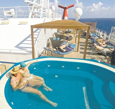 Guests aboard the Carnival Liberty relax in an adults-only areas.
