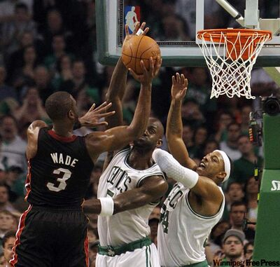 Miami's Dwyane Wade shoots over Boston's Kevin Garnett and Paul Pierce in the fourth quarter.