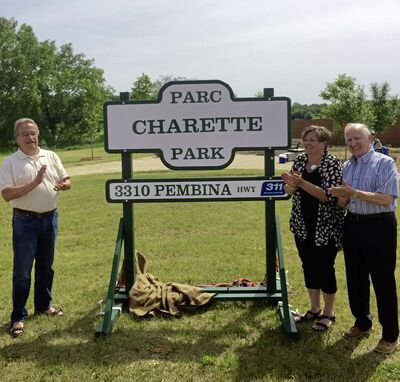 From left, Denny Lindemoen (a descendant of the Charette Family), Coun. Janice Lukes (South Winnipeg-St. Norbert), and Gabriel Forest celebrate the naming of Parc Charette Park.
